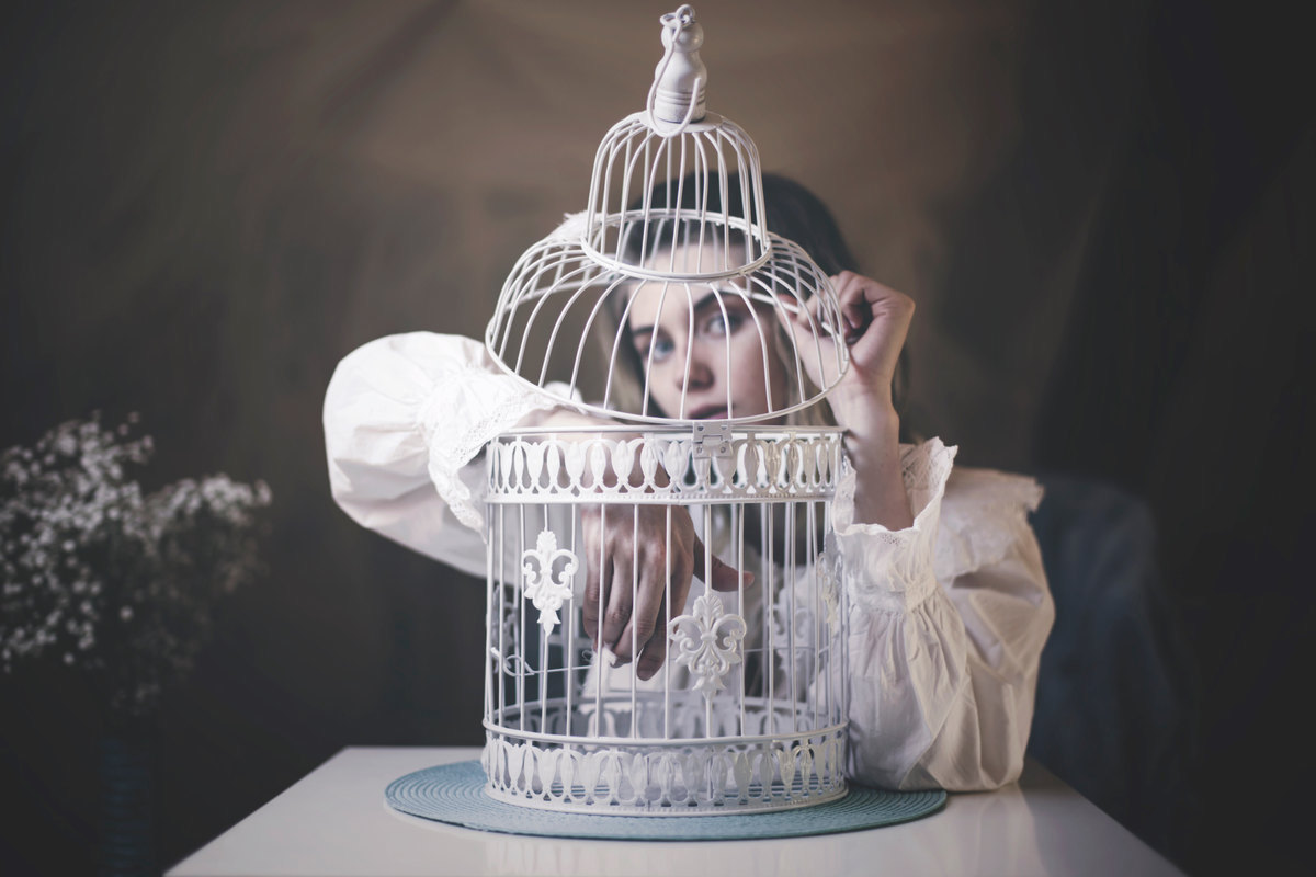 The girl and the empty cage